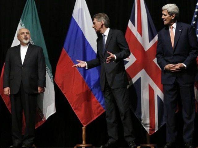 British Foreign Secretary Philip Hammond (2nd R), US Secretary of State John Kerry (R) and European Union High Representative for Foreign Affairs and Security Policy Federica Mogherini (L) talk to Iranian Foreign Minister Mohammad Javad Zarif as the wait for the Russian Foreign Minister for a group picture at the …