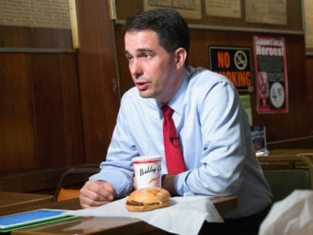 epublican presidential hopeful Wisconsin Governor Scott Walker sits for an interview during a visit to the famed Billy Goat Tavern on July 27, 2015 in Chicago, Illinois. Recent polls have Walker leading all Republican contenders in Iowa but trailing businessman Donald Trump and former Florida Governor Jeb Bush in New …