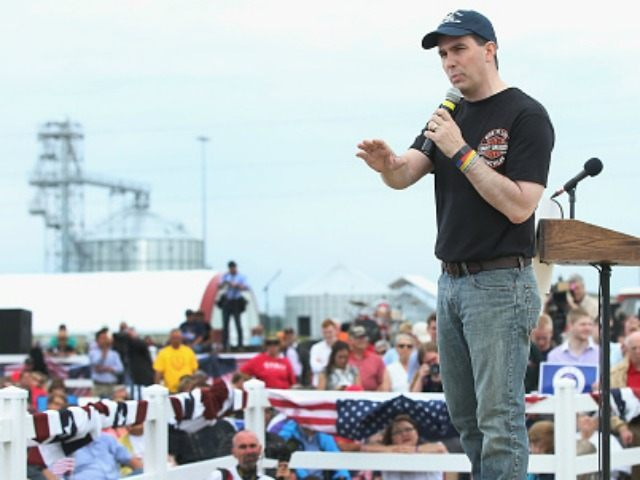 Republican presidential hopeful Wisconsin governor Scott Walker speaks at a Roast and Ride event hosted by freshman Senator Joni Ernst (R-IA) on June 6, 2015 in Boone, Iowa. Ernst is hoping the event, which featured a motorcycle tour, a pig roast, and speeches from several 2016 presidential hopefuls, becomes an …