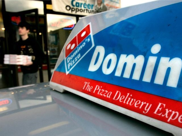 A customer leaves Domino's Pizza with 3 pies, Wednesday, Feb. 21, 2007, in Sandy, Utah. Domino's Pizza Inc. said Frida, Feb. 23, 2007 fourth-quarter profit fell 23 percent from year-ago results that included a gain on the sale of an investment in a franchise operation in Mexico. (AP Photo/Douglas C. …
