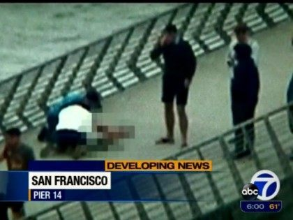 effort to revive shooting victim on pier