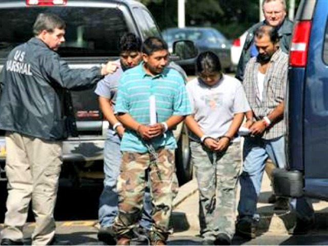 http://media.breitbart.com/media/2015/07/illegal-immigrant-arrest-AP-Rogelio-V.-Solis.jpg