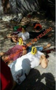 Crime scene photograph moments after Gulf Cartel hit-men executed an entire family.