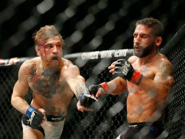 mcgregor vs mendes ufc 189 AP