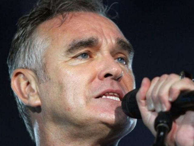 In this July 21, 2012 file photo, British rock singer Morrissey, the former front man of the alternative rock group The Smiths, sings during his concert in Tel Aviv, Israel. Health concerns are forcing Morrissey to cancel his North American tour. In a statement released Friday night, his rep says …