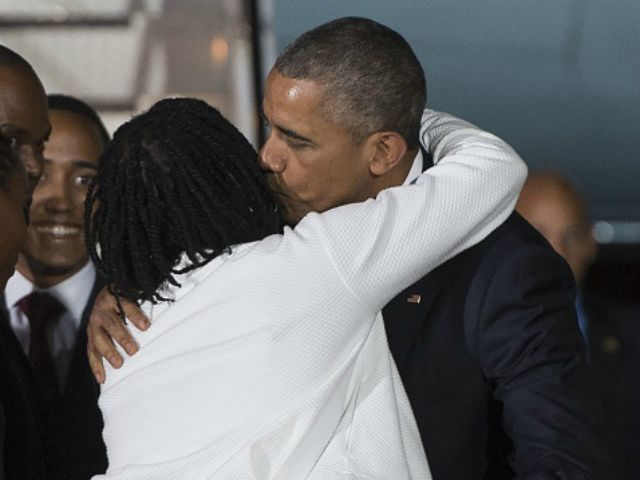 President Barack Obama is greeted by his half-sister, Auma Obama, upon his arrival at Kenyatta International Airport in Nairobi on July 24, 2015. US President Barack Obama arrived in Kenya late today, his first visit to the country of his father's birth since his election as president. AFP PHOTO / …