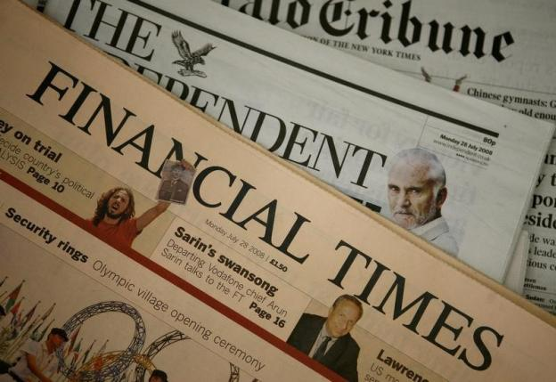 A copy of a Financial Times newspaper is displayed for sale in a newsagent in central London