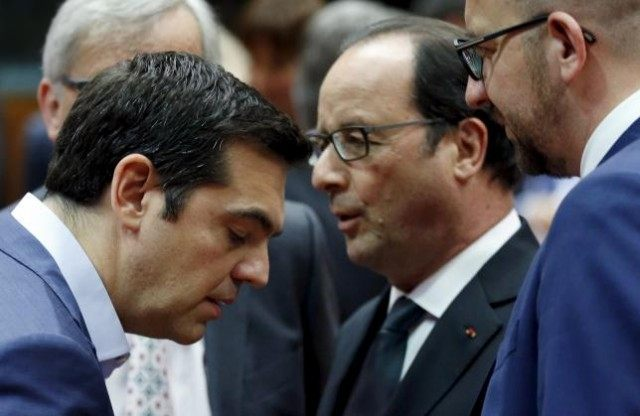 Greece's PM Tsipras listens to France's President Hollande next to Belgium's PM Michel during an euro zone leaders summit in Brussels