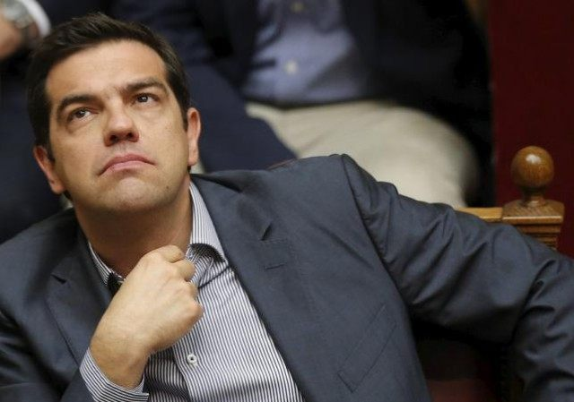 Greek Prime Minister Alexis Tsipras reacts during a voting session at the Parliament in Athens