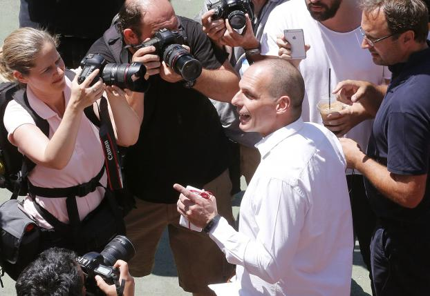 Greek Finance Minister Yanis Varoufakis leaves a polling booth after casting his ballot at a polling station in Athens
