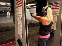 Sarah Bard, of Gilbert, shoots at Caswells Shooting Range, Tuesday, April 6, 2010 in Mesa, Ariz. in preparation for her upcoming concealed weapons test. Gov. Jan Brewer has signed into law two bills supported by gun-rights activists. One of the bills signed Monday would broaden the state's current restrictions on …