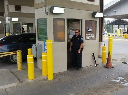 CBP officer inspects oncoming traffic in Brownsville Texas