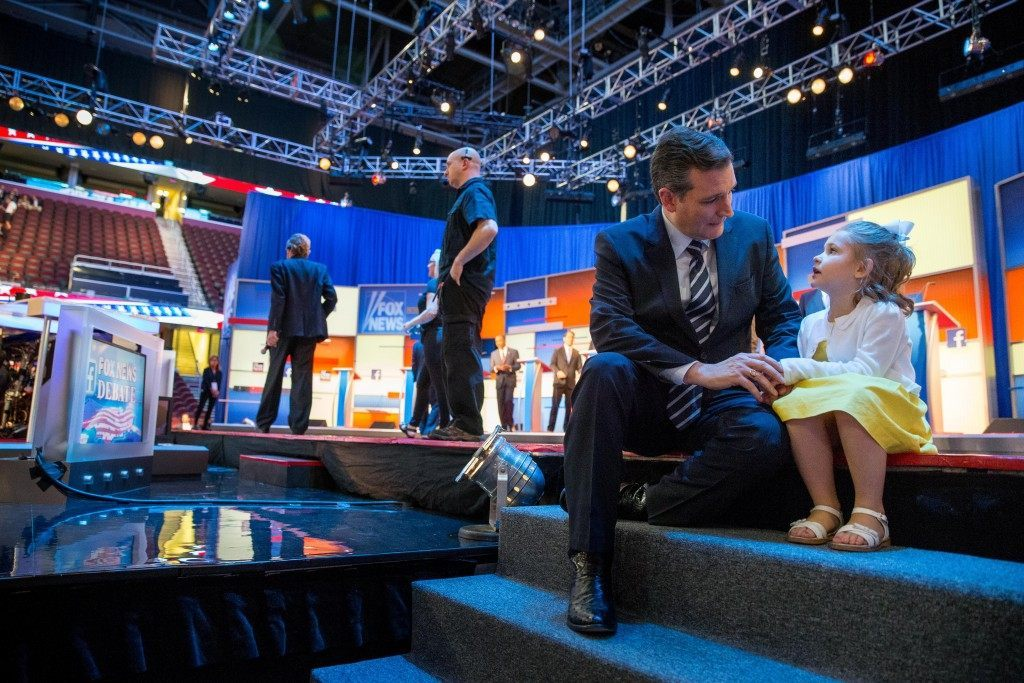 Republican presidential candidate Sen. Ted Cruz, R-Texas, chats with his daughter Catherine, 4, during a commercial break. (AP Photo/Andrew Harnik)