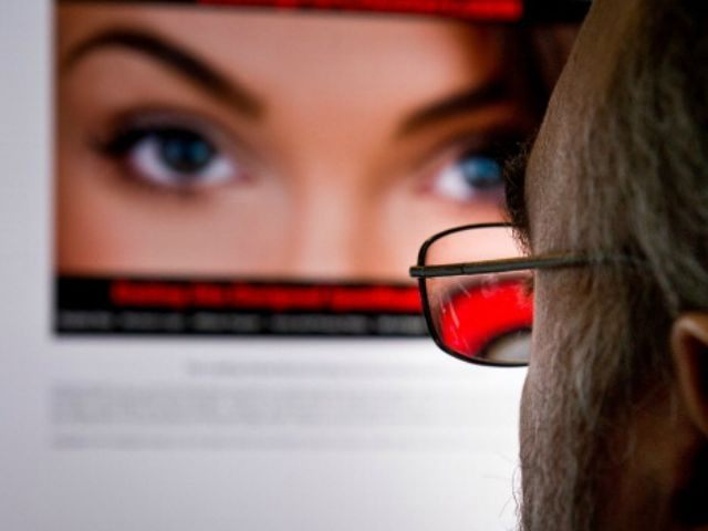 A man looks at a dating site on his computer in Washington,DC on February 10, 2014. One 29-year-old woman says it helped her take revenge on her unfaithful husband. A 45-year-old married man says it has helped prevent the break-up of his family. For millions, adultery via the Internet has …
