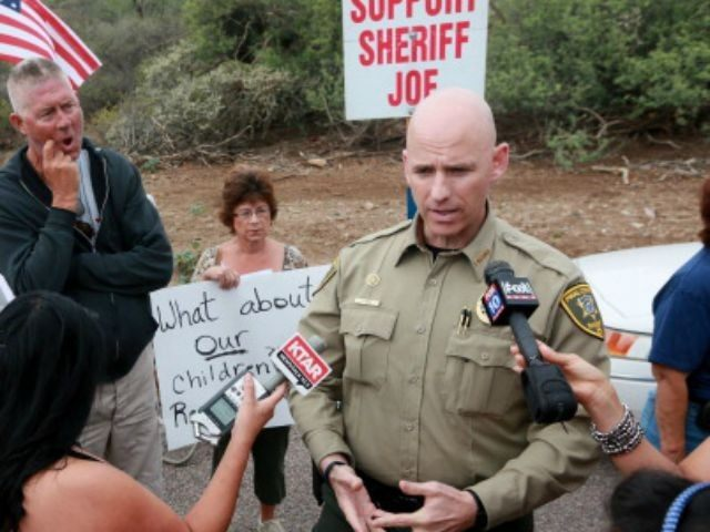 Pinal County Head Sheriff Paul Babeu speaks with anti-immigration activists and the media during a protest along Mt. Lemmon Road in anticipation of buses carrying illegal immigrants on Jully 15, 2014 in Oracle, Arizona. About 300 protesters lined the road waiting for a busload of illegal immigrants who are to …