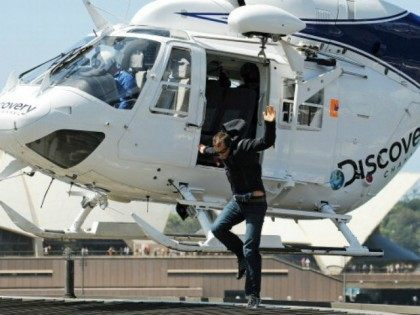 Bear Grylls, star of the hit adventure and survival series Man vs. Wild arrives by helicopter in front of the Sydney Opera House for a press conference in Sydney on March 4, 2011. Grylls was in Sydney to promote two episodes of his show filmed in Australia's Northern Territory and …