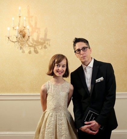 Sydney Lucas (L) and Alison Bechdel of 'Fun Home,' winner of the award for Best Musical, pose in the press room at the 2015 Tony Awards on June 7, 2015 in New York City. (Photo by