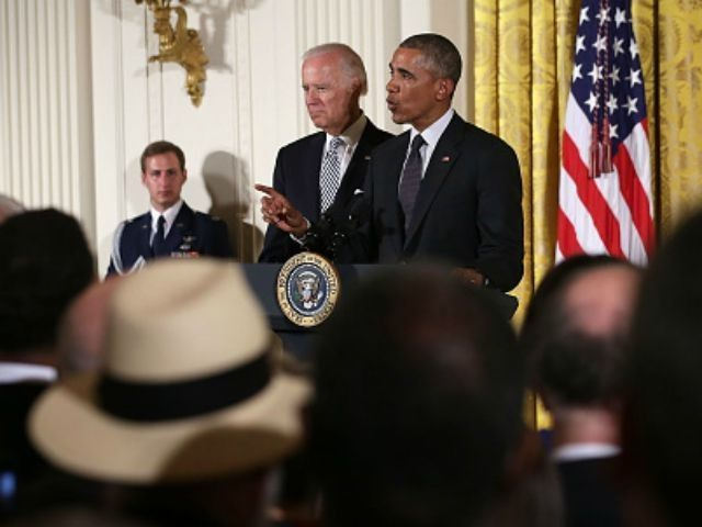 U.S. President Barack Obama (R) speaks as Vice President Joseph Biden (L) listens during a East Room Reception July 20, 2015 at the White House in Washington, DC. President Obama held a reception to mark the 25th anniversary of the Americans with Disabilities Act. (Photo by