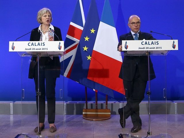 Home Secretary Theresa May Signs Deal With French Over Calais Migrant Crisis