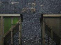 Coal harvested from a strip mine sits behind a pair of coupled coal cars on the grounds of Blackhawk Mining, LLC Spurlock Prep Plant on June 3, 2014 in Printer, Kentucky. New regulations on carbon emissions proposed by the Obama administration have reportedly angered politicians on both sides of the …