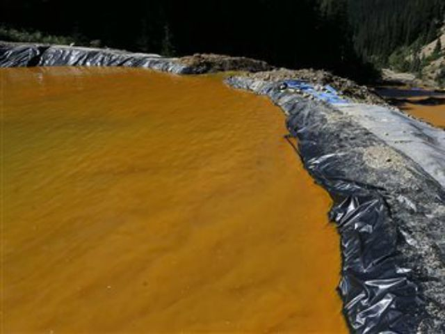 Water flows through a series of sediment retention ponds built to reduce heavy metal and chemical contaminants from the Gold King Mine wastewater accident, in the spillway about 1/4 mile downstream from the mine, outside Silverton, Colo., Friday, Aug. 14, 2015. Officials have said that federal contractors accidentally released more …