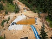 A settling pond is used at Cement Creek, which was flooded with millions of gallons of mining wastewater, on August 11, 2015 in Silverton, Colorado. The Environmental Protection Agency uses settling ponds to reduce the acidity of mining wastewater so that it carries fewer heavy metals. (Photo by