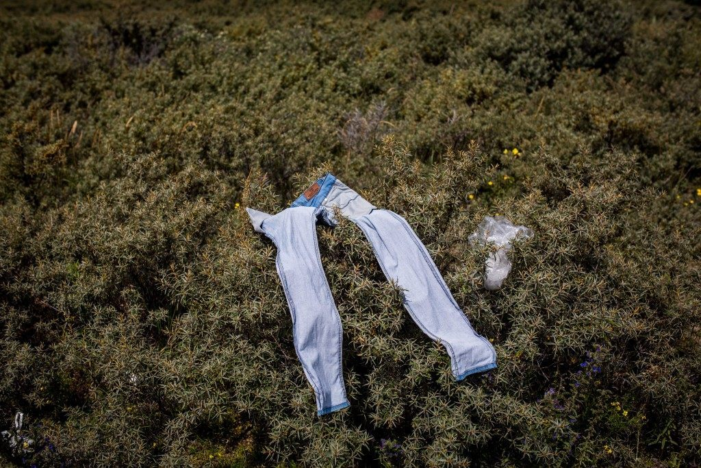 A pair of trousers are laid out to dry on bushes (Rob Stothard/Getty Images)