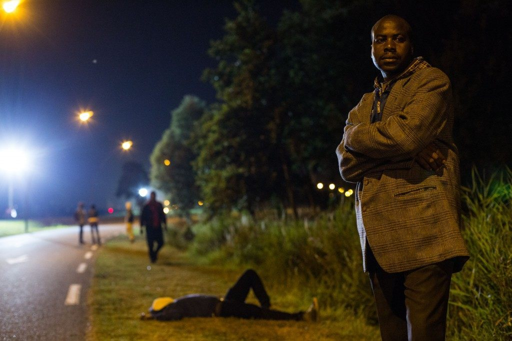 Men gather on a road leading to the Eurotunnel terminal (Rob Stothard/Getty Images)