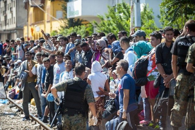 Migrants wait on a platform to get a permission from police to board a train to Serbia (ROBERT ATANASOVSKI/AFP/Getty Images)
