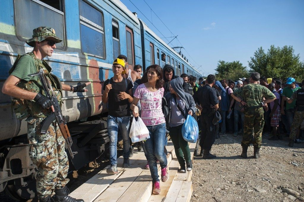 Migrants board a train to Serbia in the new reception center near the town of Gevgelija. (ROBERT ATANASOVSKI/AFP/Getty Images)