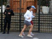 Joggers pass the Presidential residence in Guatemala city on August 27, 2015.