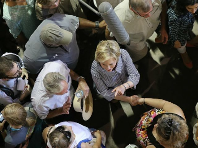 Democratic presidential candidate Hillary Clinton greets fairgoers while campaigning at the Iowa State Fair on August 15, 2015 in Des Moines, Iowa. Presidential candidates are addressing attendees at the Iowa State Fair on the Des Moines Register Presidential Soapbox stage and touring the fairgrounds. The State Fair runs through August …