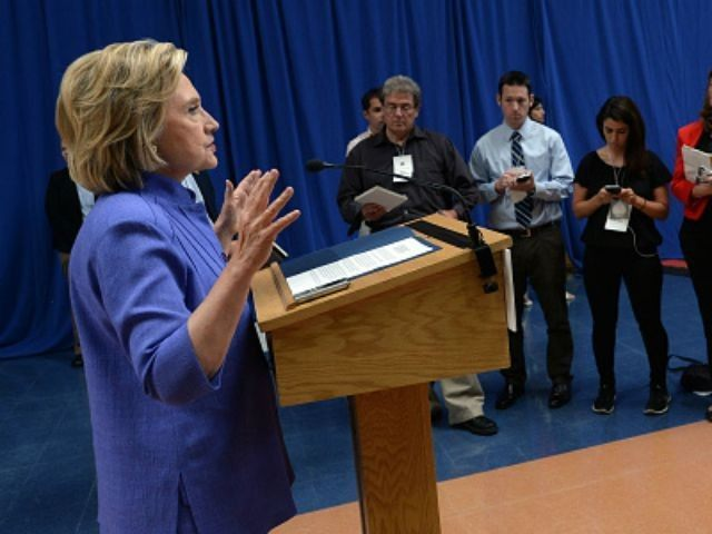 Democratic presidential candidate Hillary Clinton takes questions from reporters following a town hall meeting at Exeter High School August 10, 2015 in Exeter, New Hampshire. Clinton answered questions about Donald Trump's recent comments regarding women.