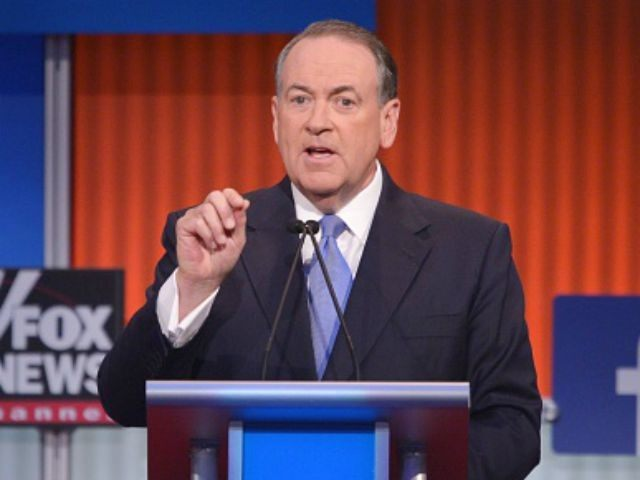 Former Arkansas governor Mike Huckabee speaks during the prime time Republican presidential debate on August 6, 2015 at the Quicken Loans Arena in Cleveland, Ohio. AFP PHOTO/MANDEL NGAN (Photo credit should read MANDEL NGAN/AFP/Getty Images)