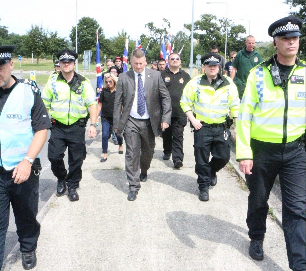 Members of Britain First accompanied by police