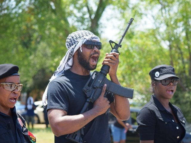 Members of armed and uniformed New Black Black Panthers Party march on Waller County jail. (Photo: Breitbart Texas/Bob Price)
