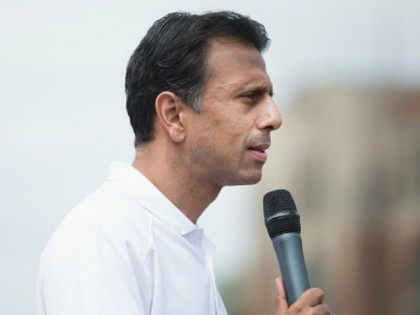 Republican presidential candidate Louisiana Governor Bobby Jindal speaks to visitors at the Iowa State Fair on August 22, 2015 in Des Moines, Iowa. Presidential candidates have a long tradition of making campaign stops at the fair. (Photo by