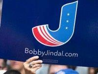 A visitor shows support for Republican presidential candidate Louisiana Governor Bobby Jindal while listening to him speak at the Iowa State Fair on August 22, 2015 in Des Moines, Iowa. Presidential candidates have a long tradition of making campaign stops at the fair. (Photo by