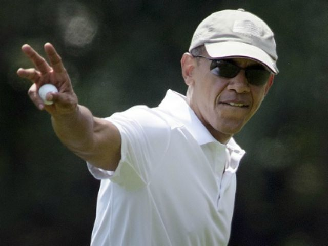 President Barack Obama waves while leaving a green during a round of golf at Farm Neck Golf Club August 15, 2015 in Oak Bluffs, Massachusetts on Martha's Vineyard. Obama golfed with former US President Clinton, Vernon Jordan and Ron Kirk. AFP PHOTO/BRENDAN SMIALOWSKI