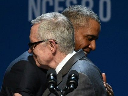 U.S. Senate Minority Leader Harry Reid (D-NV) (L) embraces U.S. President Barack Obama as Reid introduces him for a keynote address at the National Clean Energy Summit 8.0 at the Mandalay Bay Convention Center on August 24, 2015 in Las Vegas, Nevada. Political and economic leaders are attending the summit …