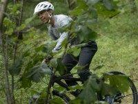 President Barack Obama rides a bike on August 22, 2015 in Vineyard Haven, Massachusetts on Martha's Vineyard. AFP PHOTO/BRENDAN SMIALOWSKI (Photo credit should read
