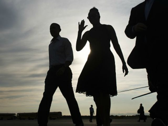 President Barack Obama (2nd L) and First Lady Michelle Obama (2nd R) walk from Marine One upon arrival on Martha's Vineyard in Massachusetts, August 7, 2015. The Obama family is starting a 2-week vacation. AFP PHOTO / SAUL LOEB (Photo credit should read