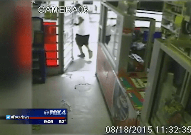 Moment of impact as store owner shoots alleged robbery suspect in the butt. (Photo: WFAA Video Screenshot)