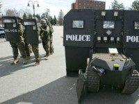 Police stand next to a SWAT robot in Sanford, Maine, during a media demonstration.