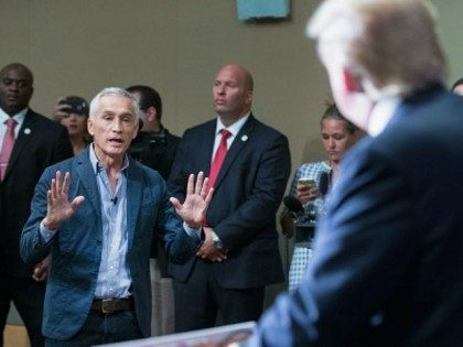 Republican presidential candidate Donald Trump fields a question from Univision and Fusion anchor Jorge Ramos during a press conference held before his campaign event at the Grand River Center on August 25, 2015 in Dubuque, Iowa. Earlier in the press conference Trump had Ramos removed from the room when he failed to yield when Trump wanted to take a question from a different reporter. Trump leads most polls in the race for the Republican presidential nomination. (Photo by