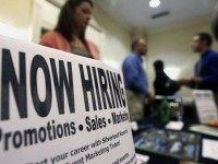 FILE - In this Thursday, Oct. 25, 2012, file photo, a sign attracts job-seekers during a job fair at the Marriott Hotel in Colonie, N.Y. The Labor Department reports on state unemployment rates for July 2015 on Friday, Aug. 21, 2015. (AP Photo/Mike Groll, File)