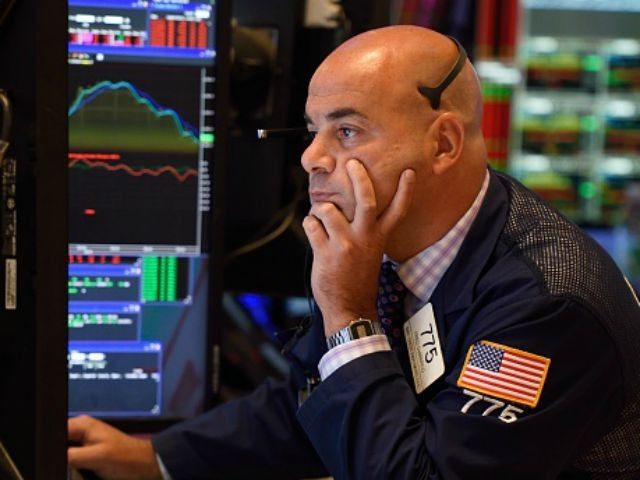 A trader on the floor of the New York Stock Exchange reads from his monitor August 24, 2015 in New York. US stocks finished sharply lower Monday, but far above the session's floor, following a bruising day in global financial markets sparked by mounting worries over the Chinese economy. US …