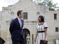 Texas Land Commissioner George P. Bush, left, talks with San Antonio Mayor Ivy Taylor before a news conference to celebrate the $31.5 million the General Land Office received for the preservation and development of the Alamo, Wednesday, Sept. 2, 2015, in San Antonio. (AP Photo/Eric Gay)