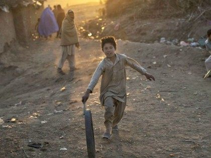 Afghan Boy Playing APMuhammed Muheisen
