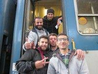 Caption: The Aleppo boys board their train for Germany in Budapest.